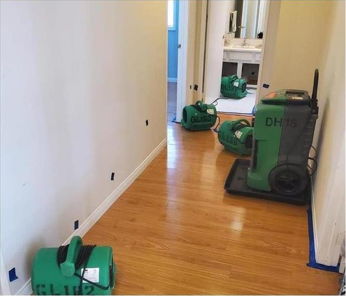 Placed SERVPRO equipment on hallway