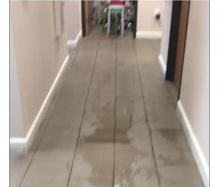 Photo of a wet hallway.