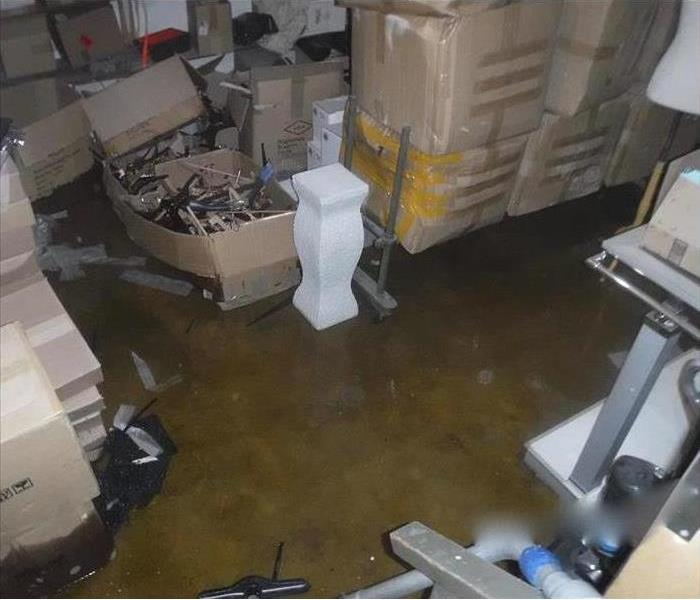 Photo of soggy boxes due to water damage.